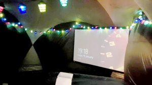 Movie screen inside a gazebo for a hot tub