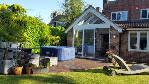 Hot tub on a patio, in front of a beautiful extended home in Berkhamsted