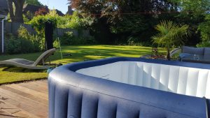 Hot tub on a patio, in front of a beautiful garden in Berkhamsted