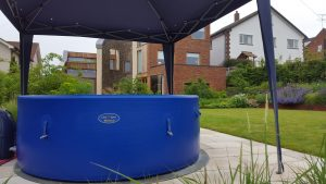 Architect designed home in Berkhamsted, hot tub in the foreground, with gazebo