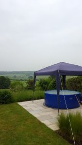 Large hot tub with gazebo, looking over rolling hills in Berkhamsted
