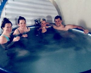 Suzanne Shaw of Hearsay, in a large hot tub with friends
