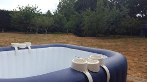 Hot tub in a large garden with drinks holder
