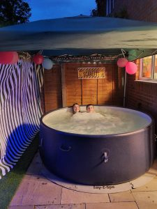 Hot tub with gazebo and 13th birthday banner