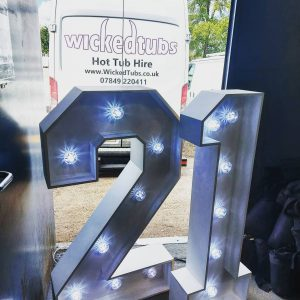 LED light-up numbers, in an open doorway, with hire van in background