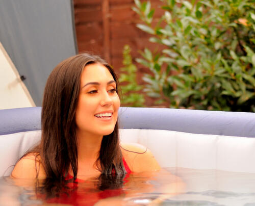 Girl sitting in hot tub