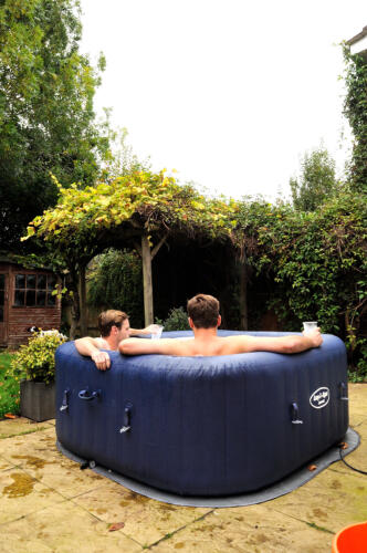 2 guys chilling in a hot tub